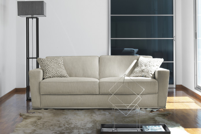 Stylish flared arm sleeper sofa with feather-wrapped foam cushions