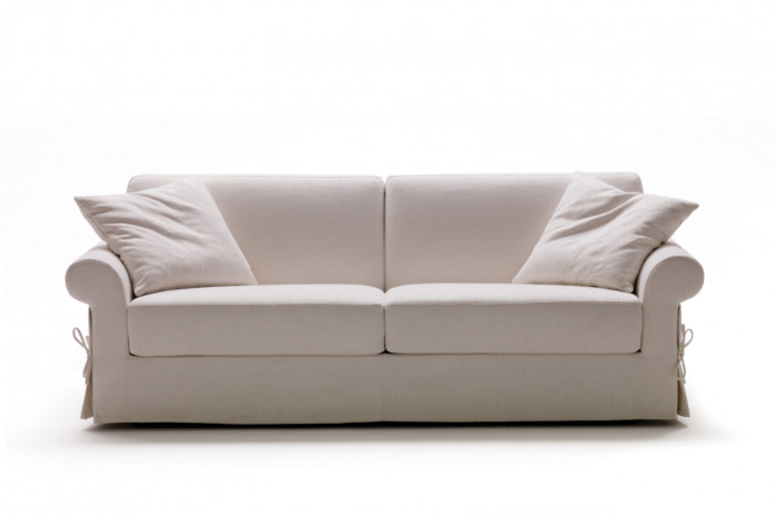 Traditional sock arm 2-3 seater sofa fitted with a skirted cover detailed with ribbons