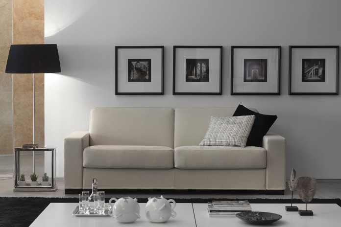 2-3 seater sofa bed with square arms and block feet