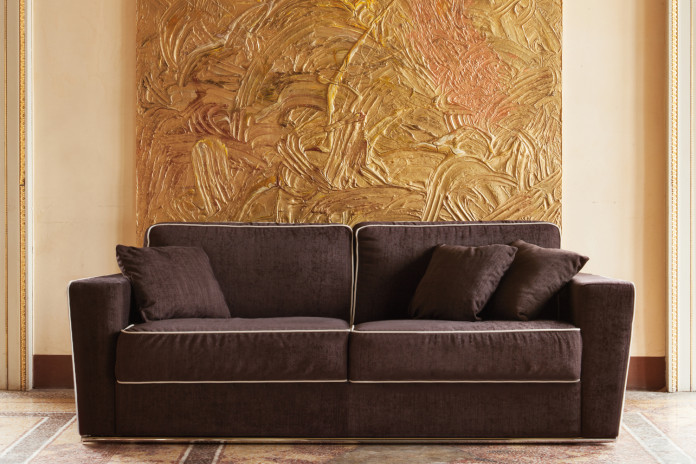Mid-century 2-3 seater sofa with contrast piping, tubular chrome base and wedge arms