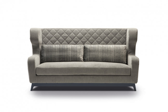 High wingback sofa detailed with a diamond tufted buttonless upholstery