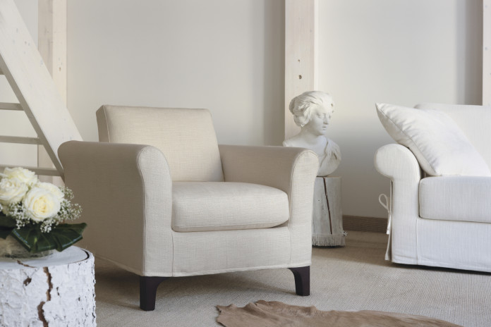 Rolled arm chair with wooden legs in natural, cherry or wenge finished ashwood, or chrome metal