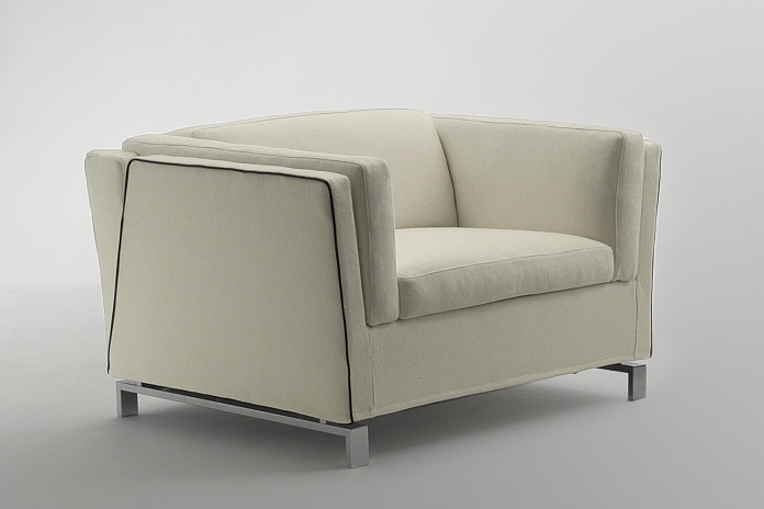 Stylish contemporary square armchair with high shelter arms