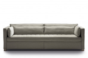 Scandinavian inspired 3-seater sofa with a tufted single-cushion seat