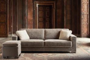 Stylish modern country sofa bed with piped edge cushions and sculptural legs