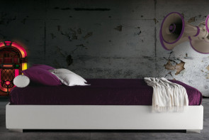 Compact upholstered ottoman bed without headboard