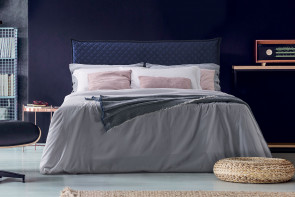 Upholstered bed with diamond quilted headboard and frame