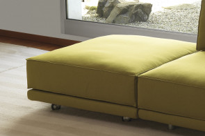 Modern footstool with casters or tubular metal legs