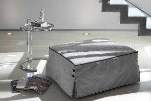 Footstool that turns into a single bed with slatted base and foam mattress