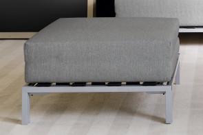 Footstool with metal legs that converts to bed