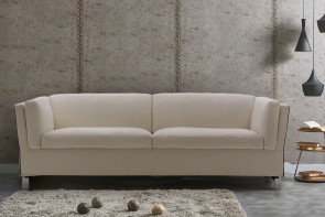 Shelter arm sofa with feather filled cushions and chrome metal legs