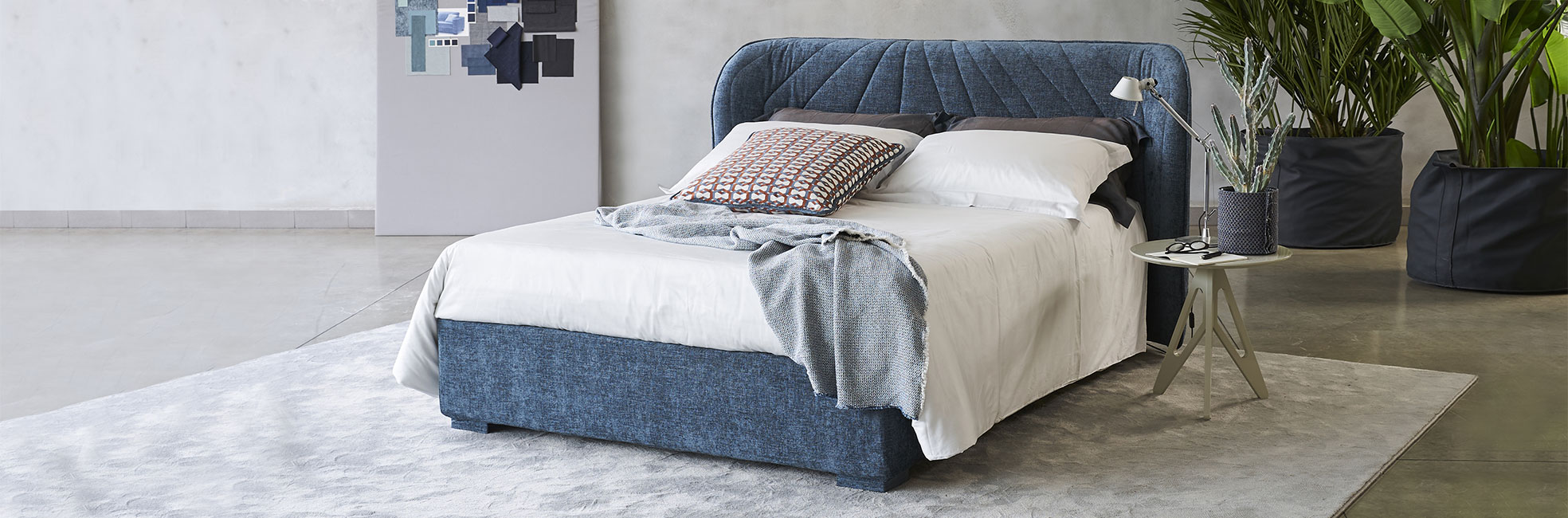 Modern winged bed with tufted headboard